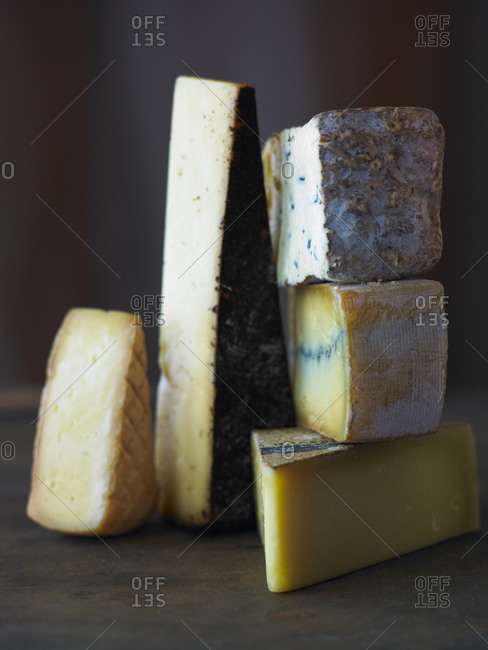 Wedges of five various cheeses