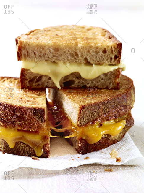Grilled cheese halves stacked