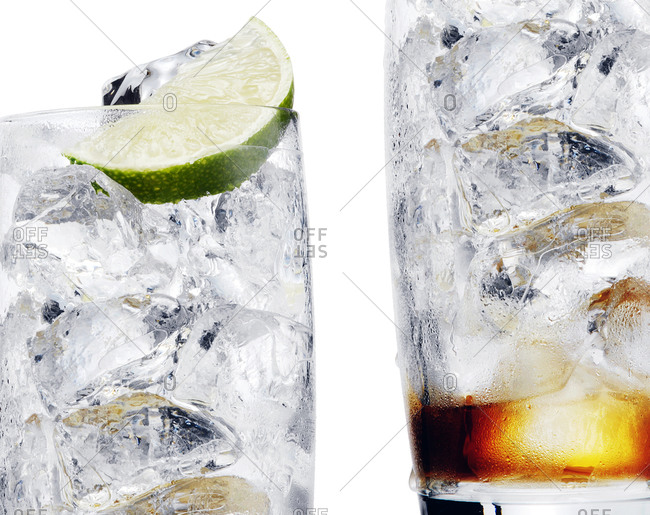 Empty glass with lime wedge and ice