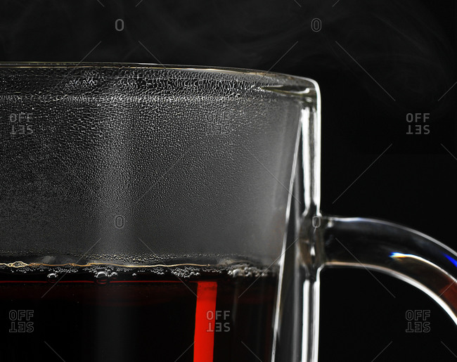 Steam and condensation of hot tea building up on glass