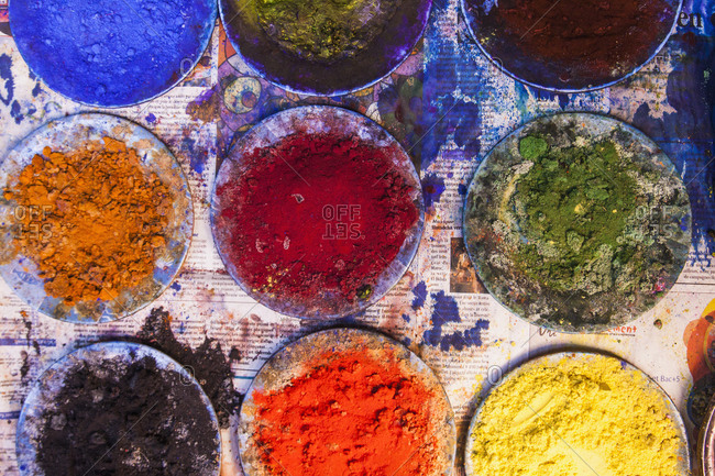 High angle view of various powder paints in plates on Holi festival
