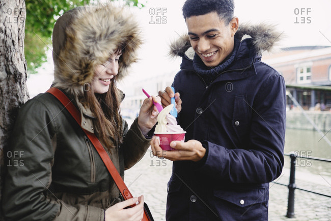 Young couple sharing ice cream in fall