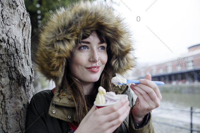 Woman wearing jacket eating ice cream