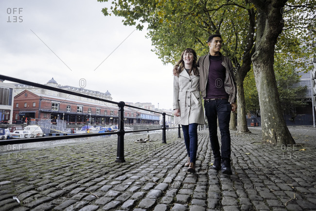 Couple strolling by canal in Bristol