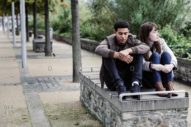 Couple sitting on bench together
