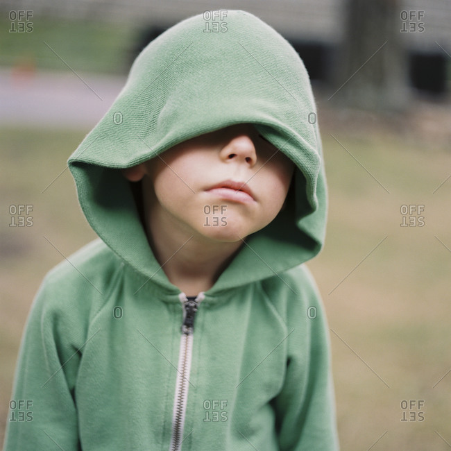 Portrait of boy with hood covering eyes
