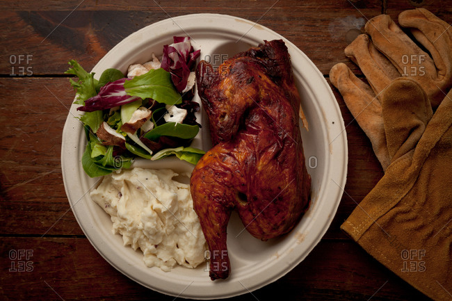 Roast chicken served with fresh salad and mashed potatoes