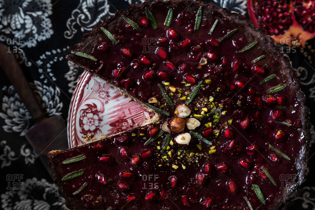 Pomegranate cake garnished with pistachios and lavender