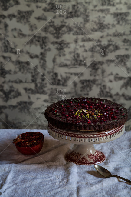 Pomegranate cake with pistachios served on a table