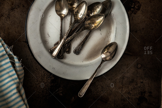 Rusty spoons on a white plate