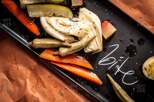 Pickled vegetables on a black plate