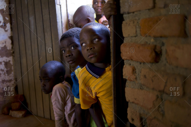Lilongwe, Malawi - April 16, 2013:Children crowd through a door at Chiponde Primary school in the Rural East District