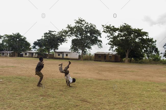 Children play in a field in Luchenza, Malawi