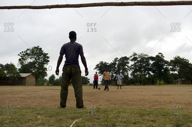 Luchenza, Malawi - April 23, 2014: Teenagers play soccer in a field