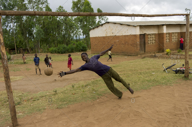 Luchenza, Malawi - April 23, 2014: Children play soccer in a field