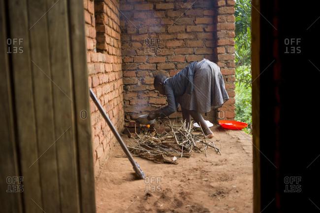 Thyolo, Malawi - April 25, 2013: A girl prepares food