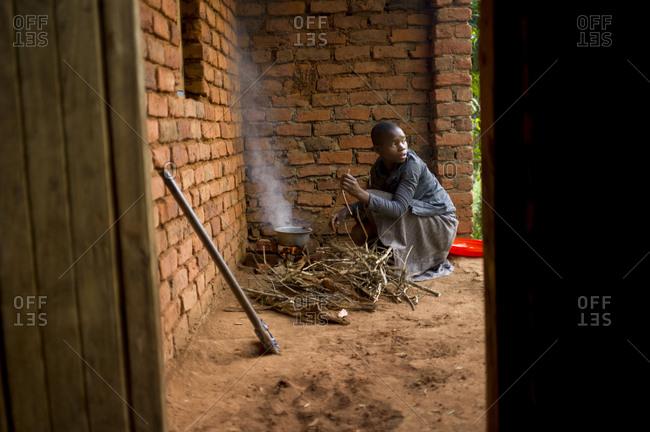 Thyolo, Malawi - April 25, 2013: A girl preparing food