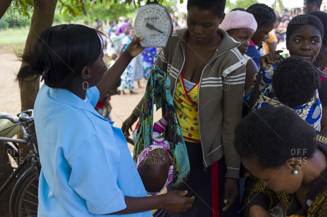 Luchenza, Malawi - April 25, 2013: HIV patients and their babies wait for their checkup at Mangunda Health Center