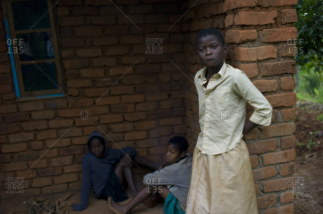 Luchenza, Malawi - April 25, 2013: Orphaned children sit outside