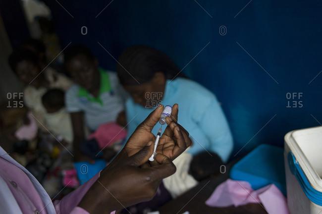 Doctor preparing to administer medication Luchenza, Malawi