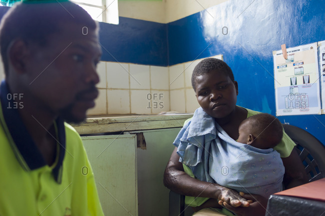 Luchenza, Malawi - April 25, 2013: A family sits in a doctor's office at Maguda Health Center