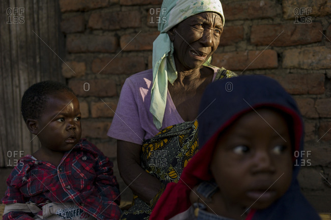 Luchenza, Malawi - April 26, 2013: An elderly woman fosters children that have lost their parents to HIV