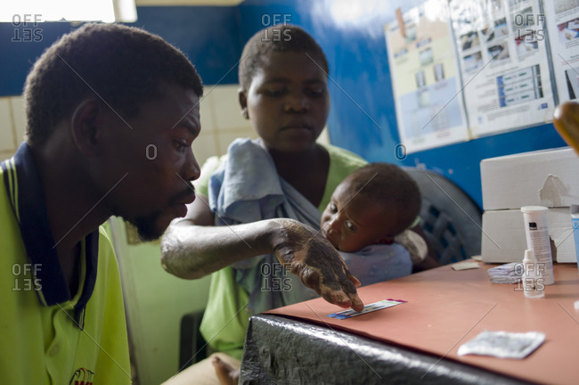 Luchenza, Malawi - April 25, 2013: A family sitting in a doctor's office at Maguda Health Center