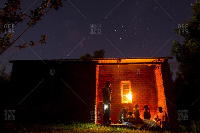 Thyolo, Malawi - April 29, 2013: Orphaned children sit outside