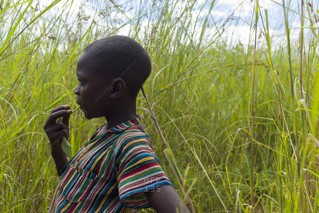 Luchenza, Malawi - April 21, 2013: A boy stands in a field