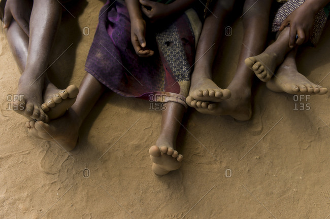 Small children sit in a row in Luchenza, Malawi