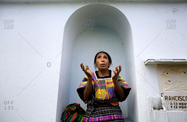 San Raymundo, Guatemala - September 7, 2007: A women prays at the grave site for a murdered Presidential Candidate