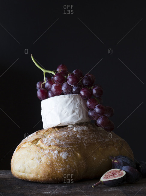 Loaf of bread and cheese with fruits