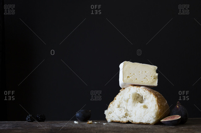 Piece of bread and cheese with figs