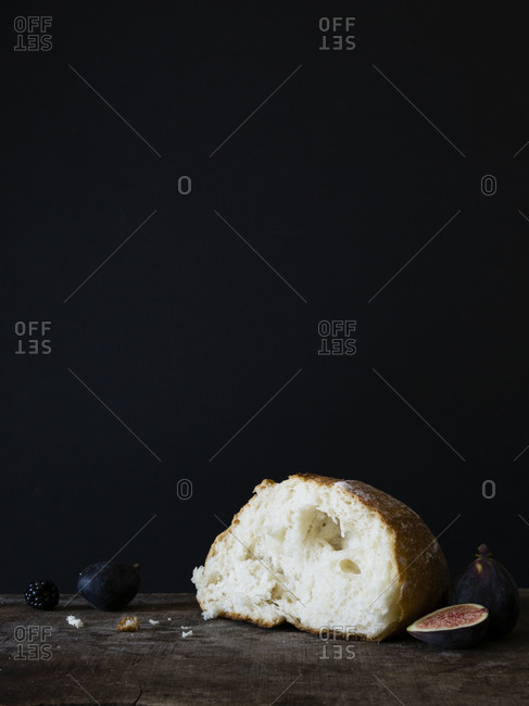 Piece of bread with ripe fruits