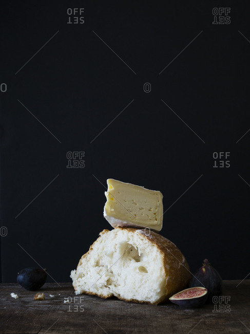 Piece of bread with camembert cheese and fig
