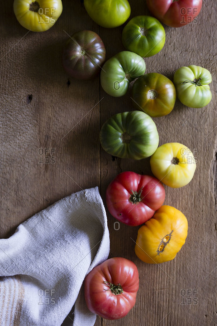Fresh heirloom tomatoes on a wooden surface