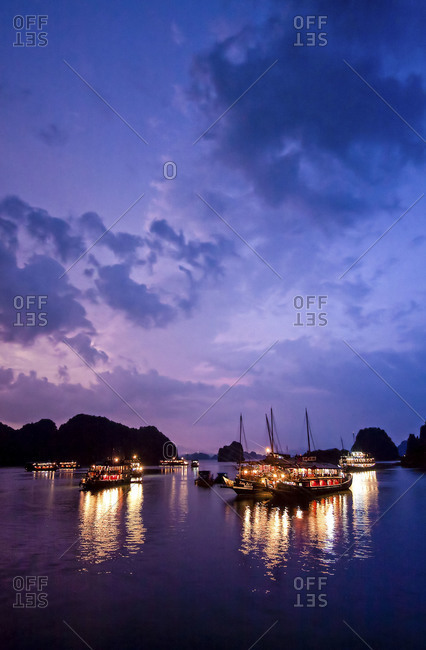 Boats Docked in the Middle of Ha Long Bay at Night, Vietnam