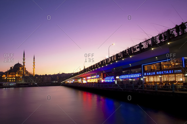 Istanbul, Turkey - January 3, 2012: View of the Bosphorus, the Suleymaniye Mosque and the Restaurants Under the Galata Bridge at Sunset
