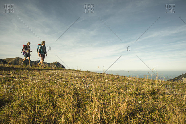 Young couple hiking, Tannheimer Tal,