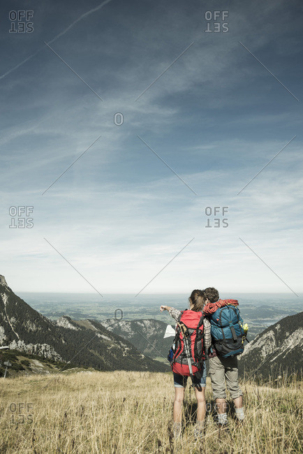 Young hikers looking at map, Tannheimer Tal,