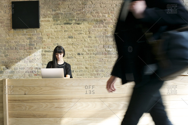 Woman working at the reception desk of an office