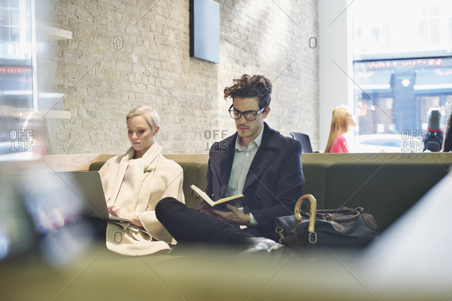 Man and woman sitting in lobby