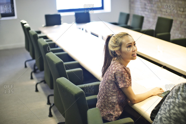 Woman sitting in conference room