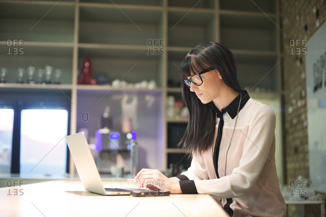 Woman working on laptop in office