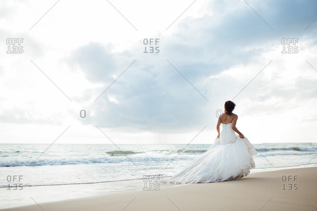 Bride walking on a seacoast