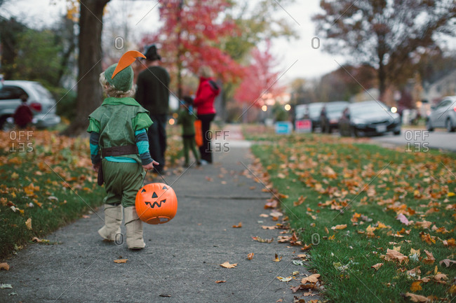 Little boy trick-or-treating on Halloween