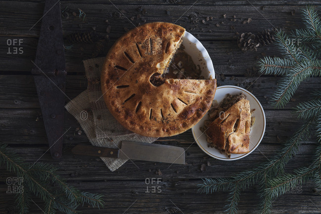 Top view of a meat pie with fir branches