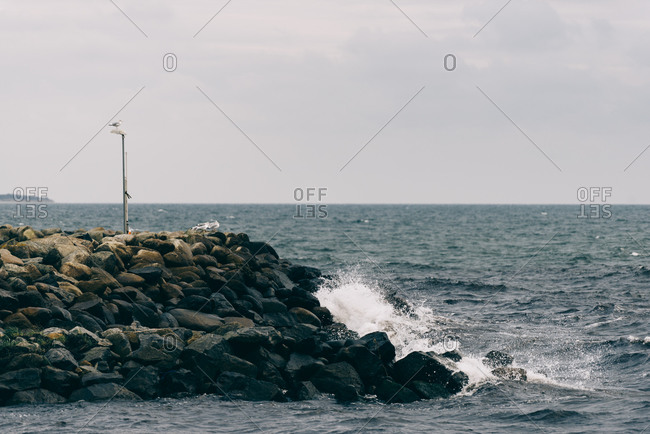 Waves breaking on the shore in Osterlen, Sweden
