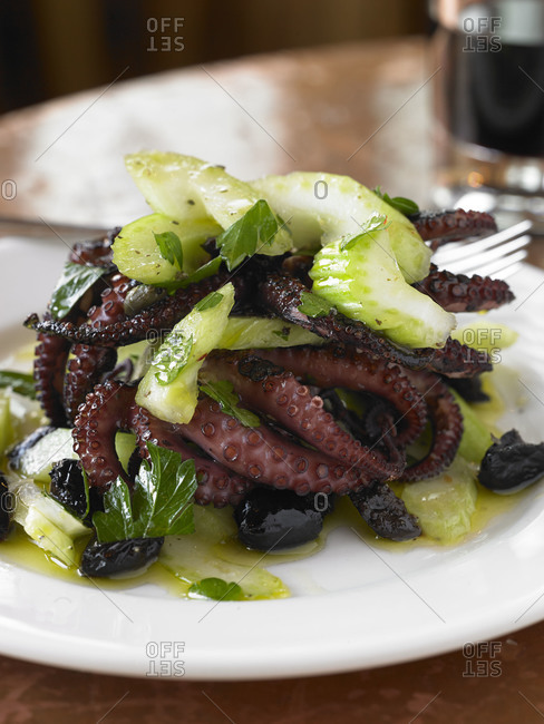 Grilled octopus with celery and black olives