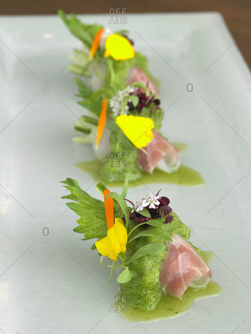Raw salmon topped with green foam